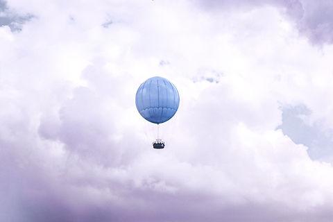 blue%20hot%20air%20balloon%20on%20clouds_edited.jpg
