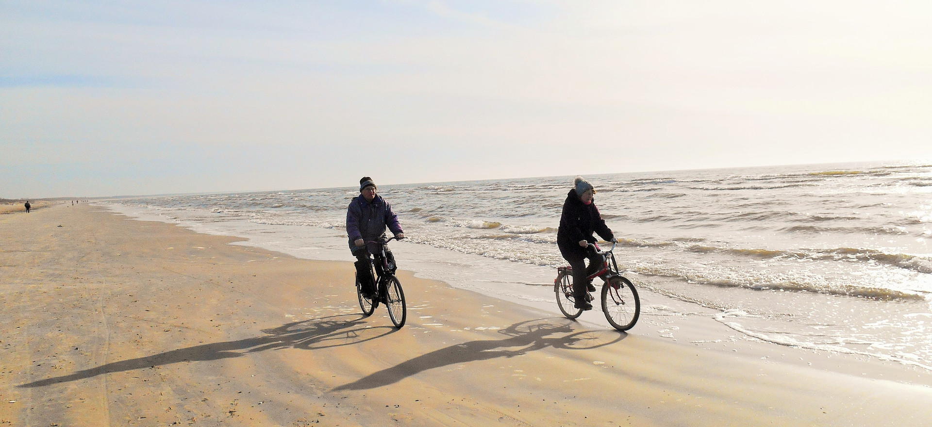 Two on bicycles singing the sea song, Liepaja, March 2017