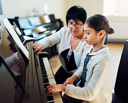 a music teacher with the pupil at the le