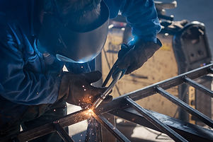 worker with protective mask welding meta