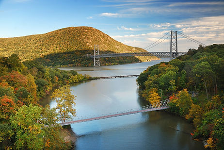 Hudson River and the Bear Mountain Bridge on a clear autumn day.
