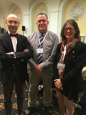 John Kelly with Dr. Silvio Paolo Mariotti, senior medical officer, WHO, Prevention of Blindness and Deafness Office, and Dr. Linda Lawrence, pediatric ophthalmologist, International Council of Ophthalmology and the American Academy of Ophthalmology