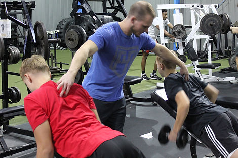 Two clients with their personal trainer.