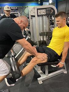 Athlete doing a leg lift.