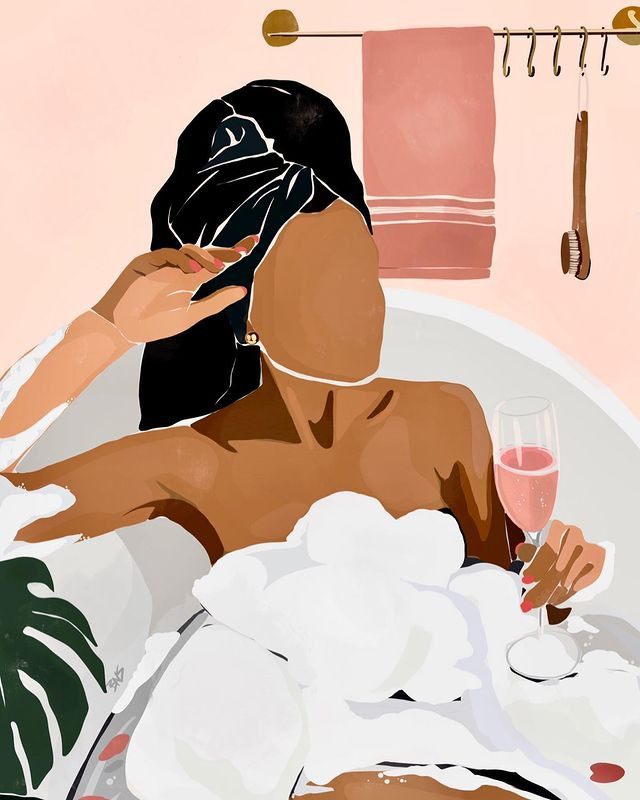 black woman in bubble bath holding glass of champagne