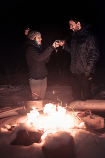 Happy guests by the bonfire