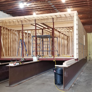 Wood framing defines the rooms.