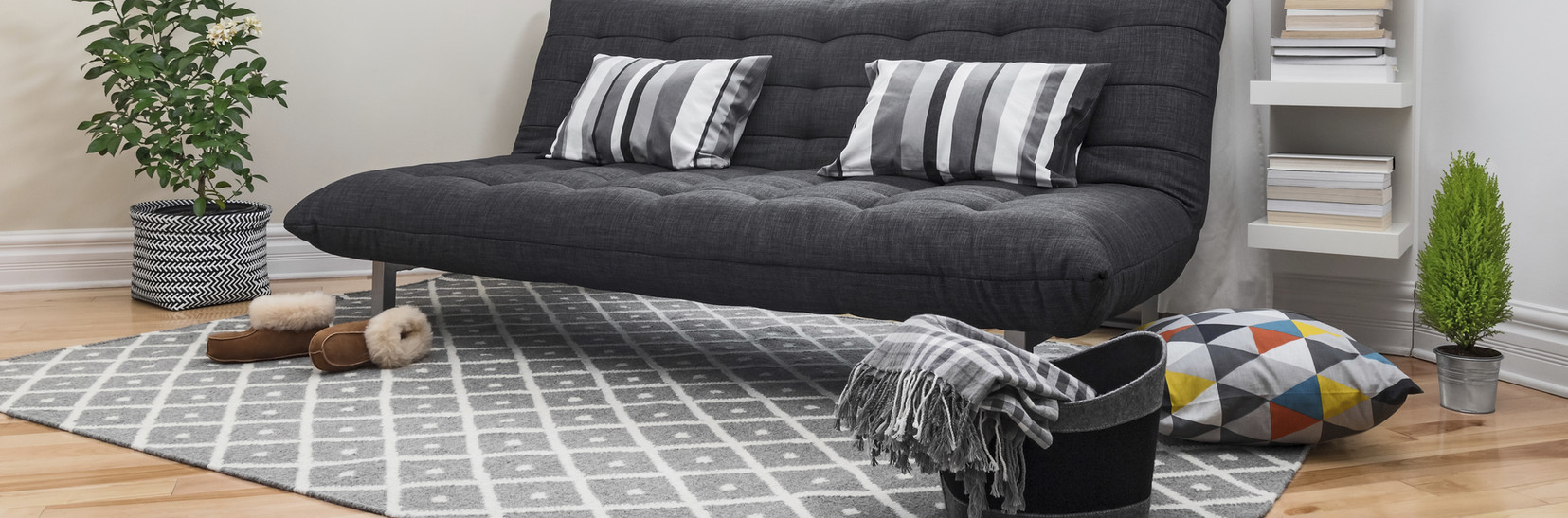 Black Couch on area rug