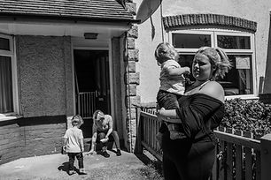 Lockdown doorsteps photo of young women with their children