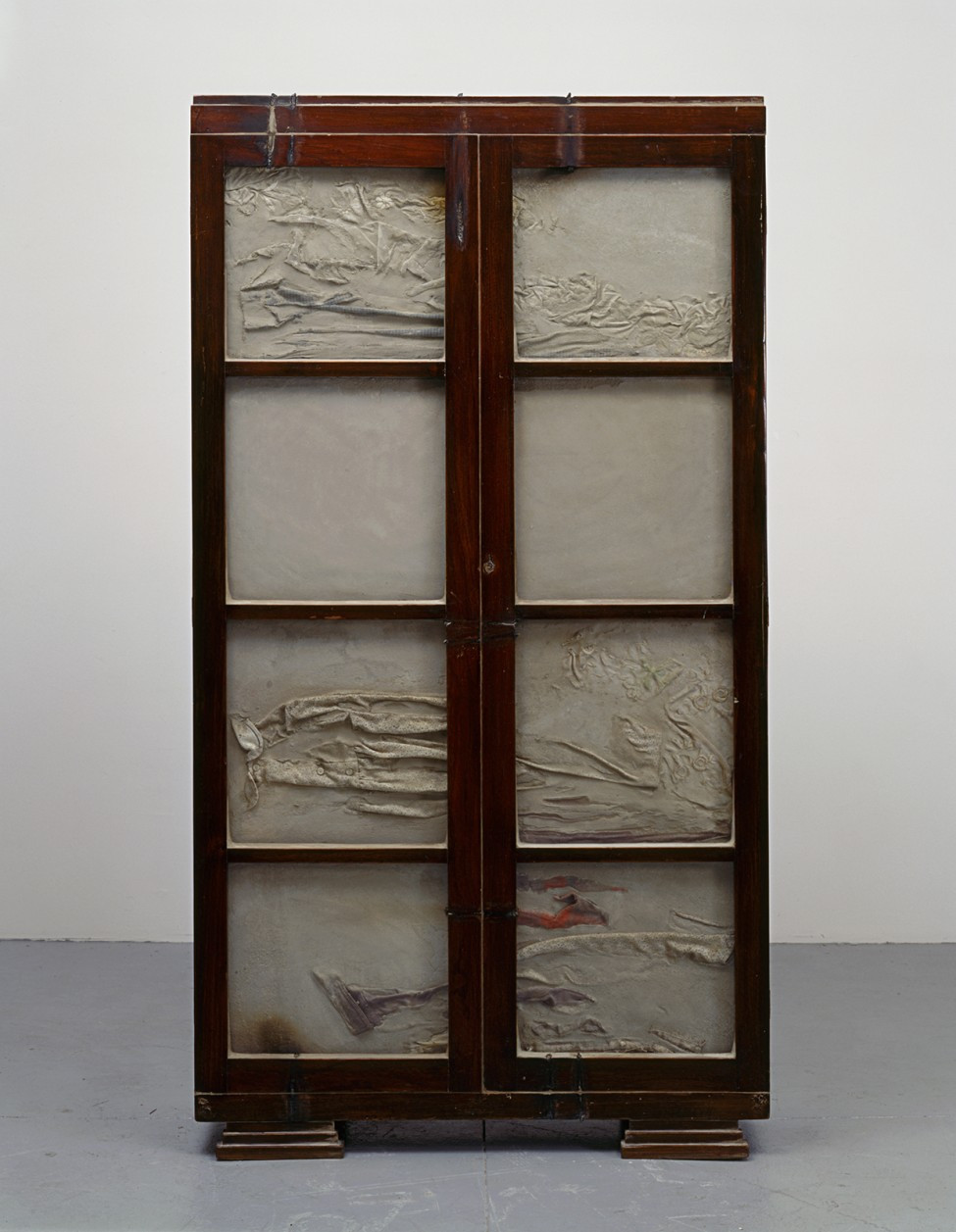 Untitled, 1998 Wooden cabinet, concrete, steel, and clothing.jpg