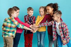 group-of-children-doing-hand-shake.jpg