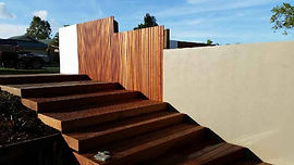 Palings & Rendered Blueboard and steps with decking materil.