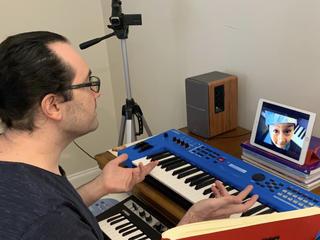 Teacher Burak with his piano student online