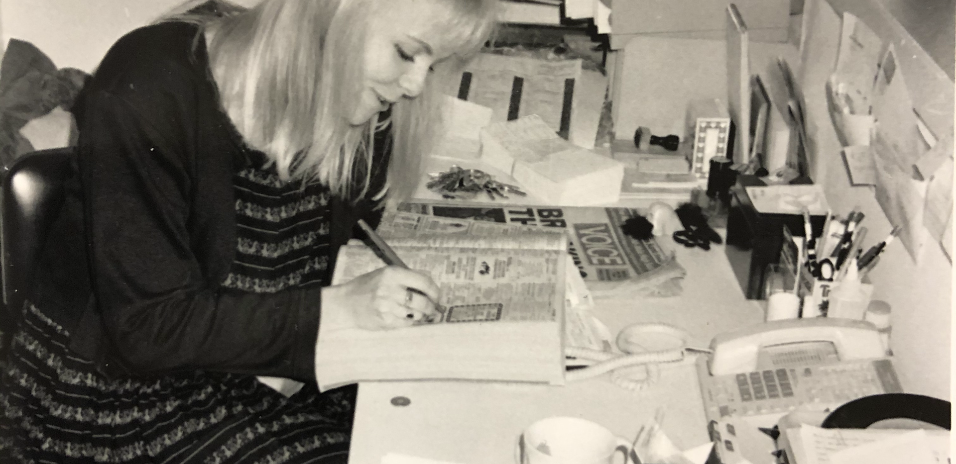 Lisa Ecklund-Flores at front desk 311 Church Street, early 1990s