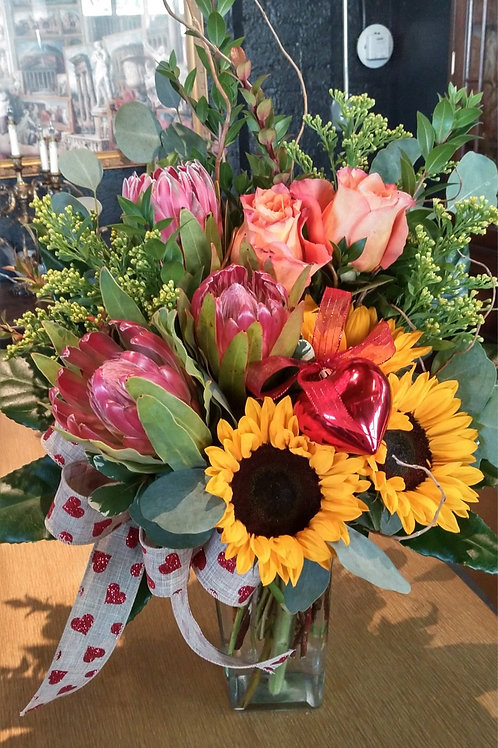 Arrangement of Protea, Sunflowers, and Roses