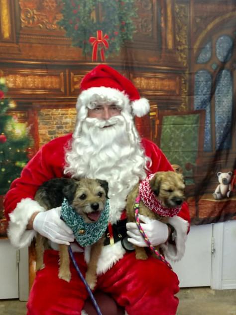 Santa with a pair of cuties
