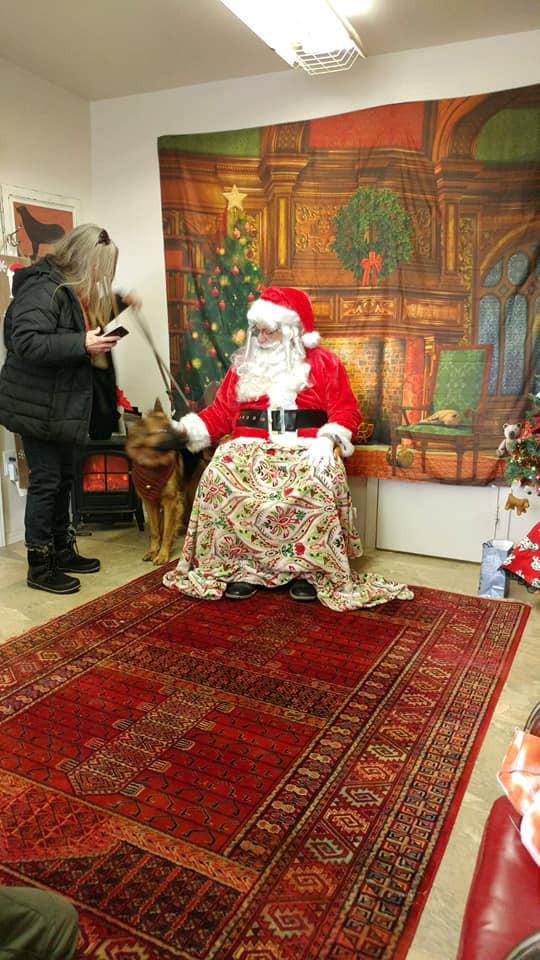 Santa staying warm with man's best friend