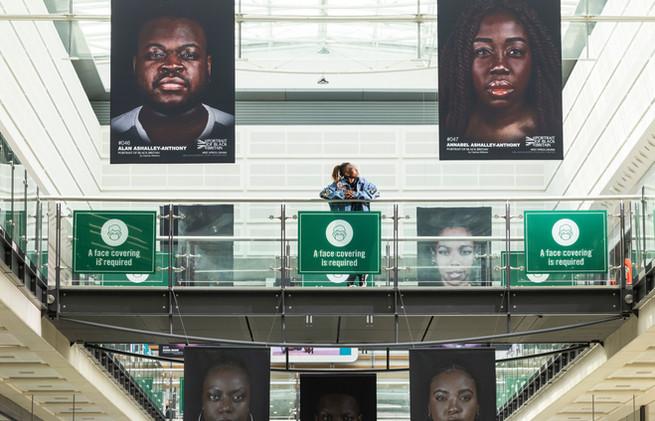 Yandass Ndlovu, a participant of Portrait of Black Britain with the installation. Photo Fa