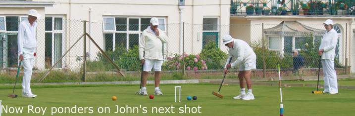 Now Roy ponders on John's next shot.JPG