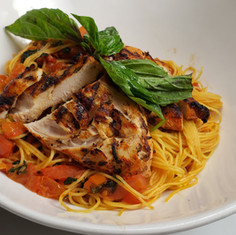Chef Polo's House-Made Pasta with Roma tomatoes, fresh garlic, basil and extra virgin olive oil, with grilled chicken