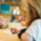 Girl-Doing-Homework-Emergency-Childcare.