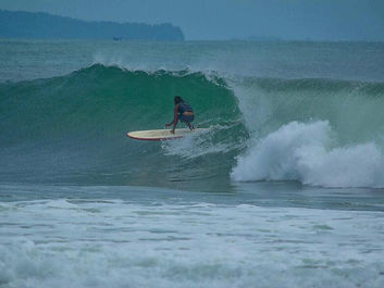 Batukaras longboard right hander advanced surfing point break South West Java