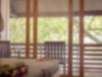 BK Homestay guesthouse balcony room overlooking Batu Karas beach