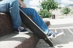 pov of a skater holding a skateboard