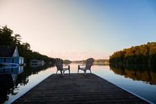muskoka-chairs-sitting-end-dock-front-la
