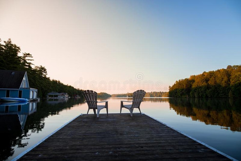 muskoka-chairs-sitting-end-dock-front-la
