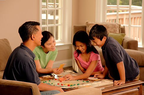 Family_playing_a_board_game_(2)_edited.jpg