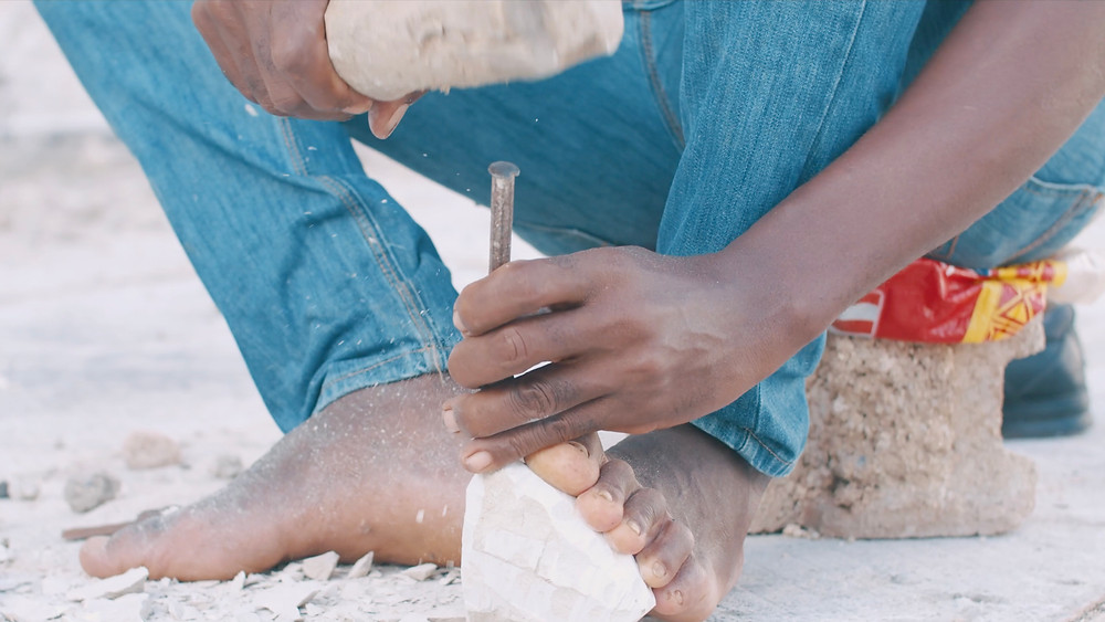 Artisan from Leogane in Haiti making a Soapstone sculpture