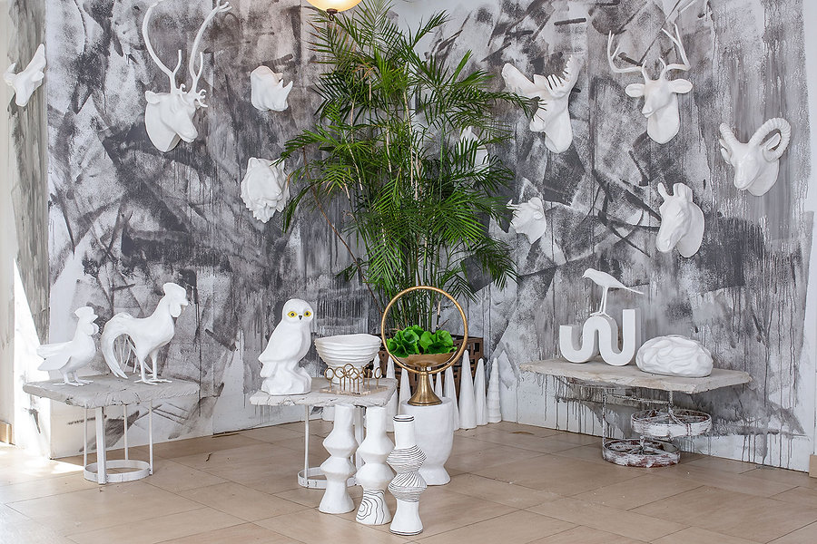 Papier mache home decorations painted in white