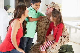 Family Greeting Military Father Home On
