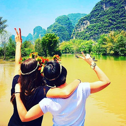Nicole and I saluting #YulongRiver after a beautiful ride on a bamboo raft #travelchina