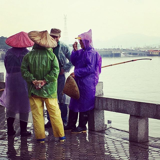 Colourful fishermen taking a break