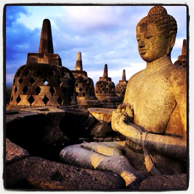 At the top of Borobudur, we have reached Nirvana! This Buddhas hand gesture denotes 'teaching'