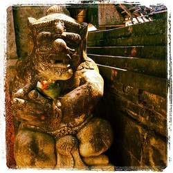 Stone guard holding an offering #indonesia #bali
