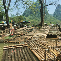 Bamboo rafts and popcorn mountains, a sight to behold from afloat the YulongRiver