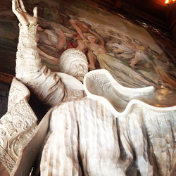 Behind this grand sculpture of Pope Urban VIII is a larger than life painting depicting 'The Rape of