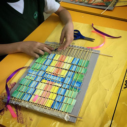 Loom weaving with my talented twos