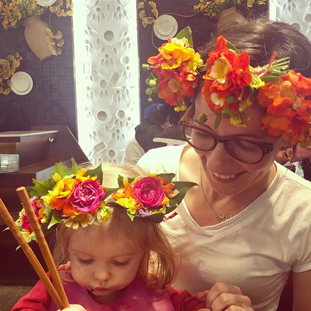 My girl and I wearing fresh flowers in our hair, enjoying a delicious bowl of noodles. Life is good
