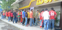 Fans line up outside the venue.