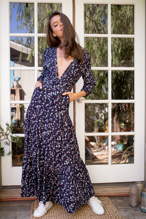 2ff3a7b390 Deep V-neck maxi dress with pockets and open back bow tie straps. Beautiful  paisley flower print dress with 3/4 sleeve.