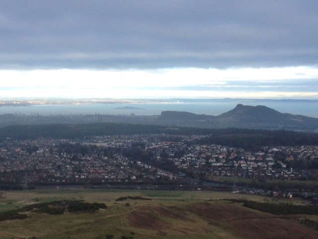 View from Hillend Ski Centre overlooking Edinburgh, Arthur Seat and Fife on our Edinburgh to East Lothian campervan trip in Scotland.