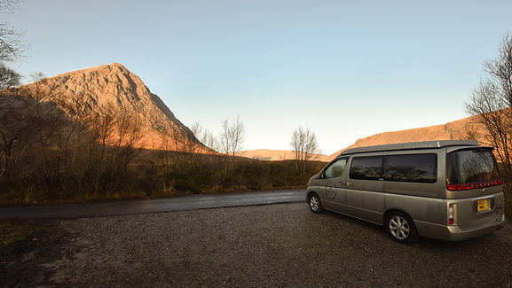 Volkswagon Campervan on hire in Glencoe in the Highlands of Scotland overlooking Buachaille Etive Mor mountain in Scotland.
