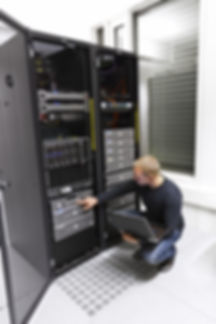 consultant working in a data center. Ma