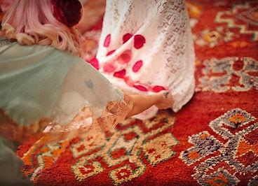 Bridesmaid adjusting the wedding dress