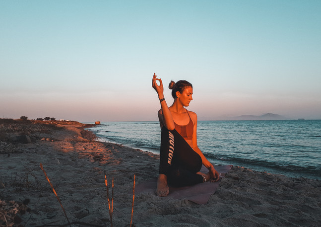 Sunrise yoga at the beach
