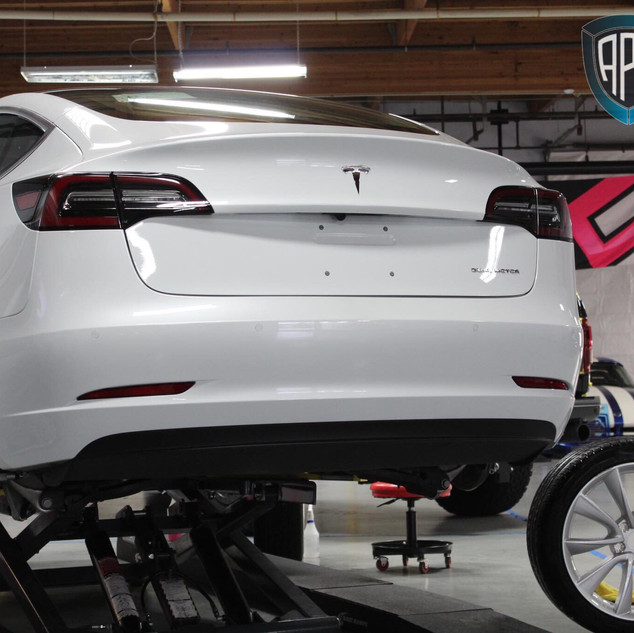 Tesla wheels off Ceramic Pro Pacakge.